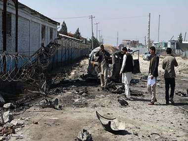 Six injured after suicide car bomber strikes at Afghan Election Commission HQ in Kabul vehicle exploded after cops opened fire