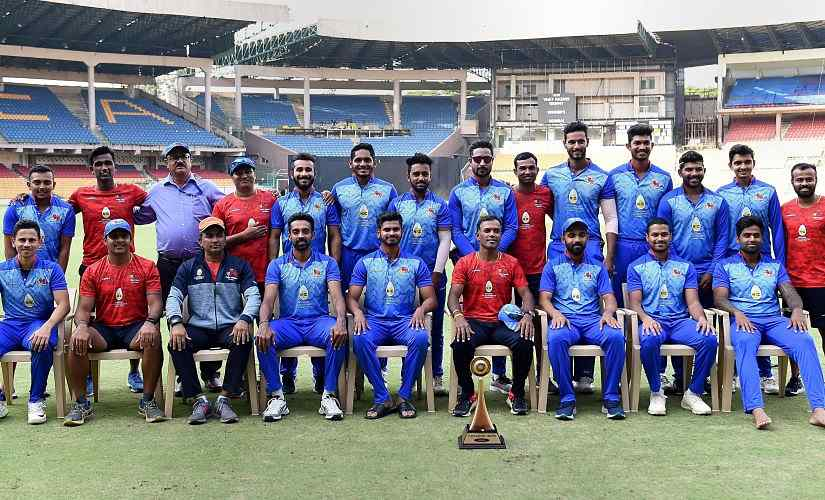 Mumbai players and staff pose with the Vijay Hazare trophy after beating Delhi in finals. PTI