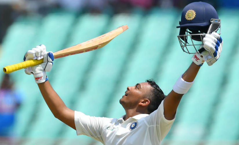 Prithvi Shaw celebrates after scoring his century on Test debut. Reuters