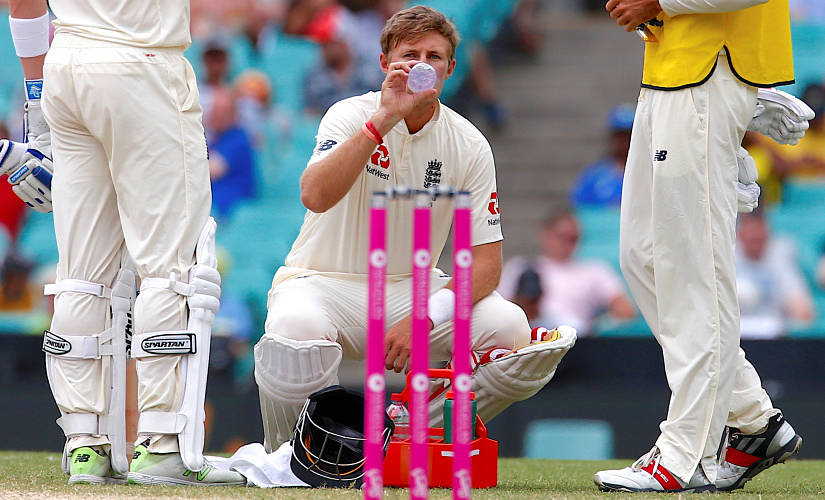 A struggling Joe Root has a quick sip at the SCG in January this year. Reuters