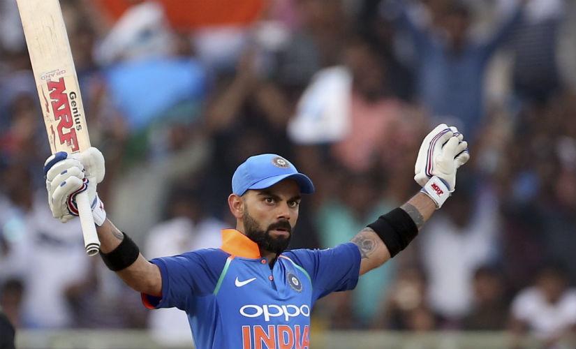 Virat Kohli slammed an unbeaten 157 to guide India to 321/6, smashing records along the way. AP