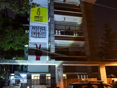 Amnesty India says its structure compliant with Indian laws alleges govt instilling fear by conducting such raids