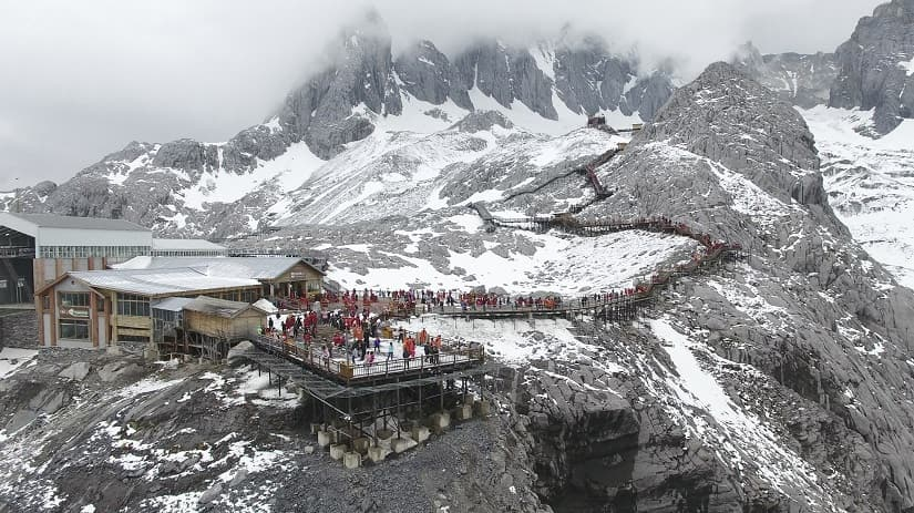 Worlds fastest melting glacier in China draws tourists climate worries Seasonal melting feeds Yangtze Yellow Mekong Ganges