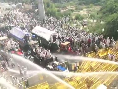 Police halt farmers march at DelhiUP border using water cannons tear gas shells protesters break barricades