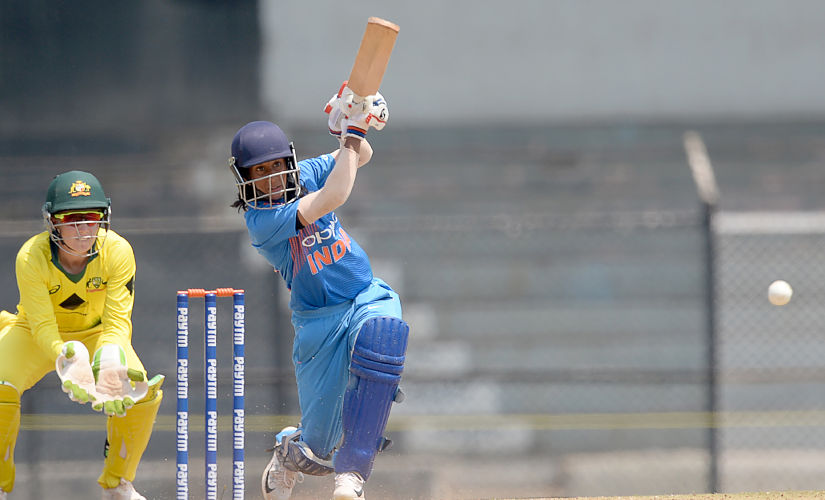 India cricketer Jemimah Rodrigues (R) plays a shot during the fourth cricket match of the women's Twenty20 (T20) tri-series between India and Australia at Brabourne Stadium in Mumbai on March 26, 2018. (Photo by PUNIT PARANJPE / AFP) / ----IMAGE RESTRICTED TO EDITORIAL USE - STRICTLY NO COMMERCIAL USE----- / GETTYOUT