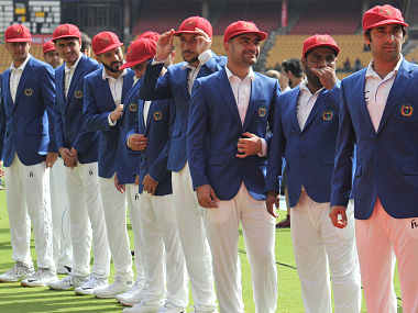 Members of the Afghan cricket team led by captain Mohammad Asghar Stanikzai (R) stand as they welcome their Indian opponents prior to the start of the one-off cricket Test match between India and Afghanistan at The M. Chinnaswamy Stadium in Bangalore on June 14, 2018. (Photo by Manjunath KIRAN / AFP) / ----IMAGE RESTRICTED TO EDITORIAL USE - STRICTLY NO COMMERCIAL USE----- / GETTYOUT