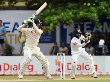 England's cricketer Keaton Jennings (L) plays a shot as Sri Lanka's wicketkeeper Niroshan Dickwella looks on during the second day of the opening Test match between Sri Lanka and England at the Galle International Cricket Stadium in Galle on November 7, 2018. (Photo by ISHARA S. KODIKARA / AFP)