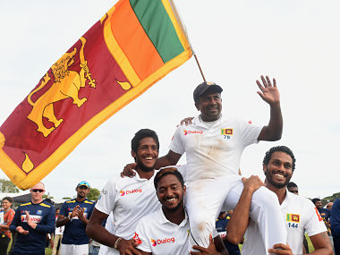 Sri Lanka's Rangana Herath (centre R) is carried off the field by teammates as he waves to fans after England won the opening Test cricket match against Sri Lanka at the Galle International Cricket Stadium in Galle on November 9, 2018. - Herath, who made his debut at Galle in 1999 is one away from a century of wickets at this venue to emulate countrymate Muttiah Muralitharan and Australia's Shane Warne, who have got 100 wickets each at one venue. (Photo by ISHARA S. KODIKARA / AFP)