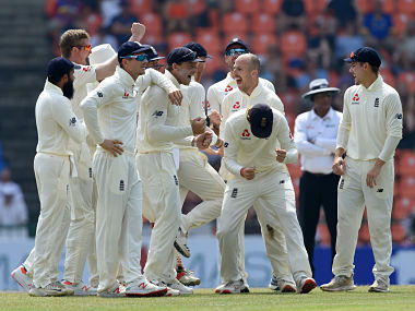 England cricketer Jack Leach (2R) celebrates with his teammates after dismissing Sri Lanka's Kusal Mendis during the fourth day of the second Test match between Sri Lanka and England at the Pallekele International Cricket Stadium in Kandy on November 17, 2018. (Photo by ISHARA S. KODIKARA / AFP)
