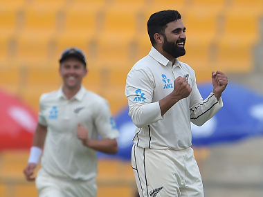 New Zealand spinner Ajaz Patel celebrates after taking the wicket of Pakistani captain Sarfraz Ahmed during the second day of the first Test cricket match between Pakistan and New Zealand at the Sheikh Zayed International Cricket Stadium in Abu Dhabi on November 17, 2018. (Photo by AAMIR QURESHI / AFP)