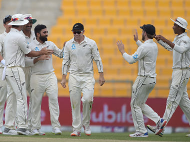 New Zealand spinner Ajaz Patel (4L) celebrates with teammates after taking the wicket of Pakistani captain Sarfraz Ahmed during the second day of the first Test cricket match between Pakistan and New Zealand at the Sheikh Zayed International Cricket Stadium in Abu Dhabi on November 17, 2018. (Photo by AAMIR QURESHI / AFP)