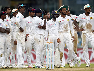 Sri Lanka's captain Suranga Lakmal (R) and teammates look on during the third umpire's dismissal of England's Moeen Ali during the first day of the third Test cricket match between Sri Lanka and England at the Sinhalese Sports Club (SSC) international cricket stadium in Colombo on November 23, 2018. (Photo by ISHARA S. KODIKARA / AFP)