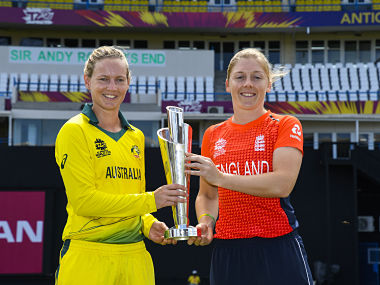 Meg Lanning (L) of Australia and Heather Knight (R) of England hold the Women's World T20 trophy at Sir Vivian Richards Cricket Ground, North Sound, Antigua and Barbuda, on November 23, 2018. - ICC Women's World T20 final match between Australia and England is to be played on November 24. (Photo by Randy Brooks / AFP)