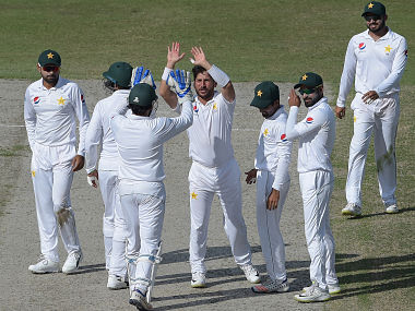 Pakistani spinner Yasir Shah (C) celebrates with teammates after taking the wicket of New Zealand batsman Ish Sodhi during the fourth day of the second Test cricket match between Pakistan and New Zealand at the Dubai International Stadium in Dubai on November 27, 2018. (Photo by AAMIR QURESHI / AFP)
