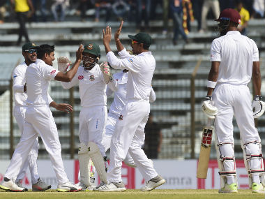 Taijul Islam celebrates the dismissal of Roston Chase in West Indies' second innings. AFP