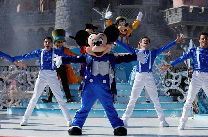Mickey Mouse turns 90 fans around the world celebrate the birthday of Walt Disneys iconic cartoon character