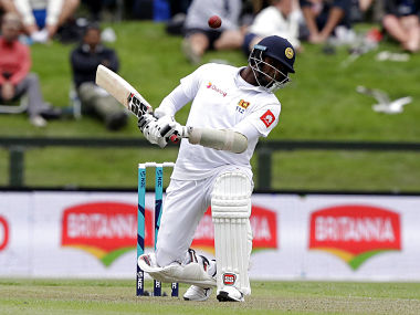 Sri Lanka's Angelo Mathews ducks to avoid a bouncer during play on day one of the second cricket test between New Zealand and Sri Lanka at Hagley Oval in Christchurch, New Zealand, Wednesday, Dec. 26, 2018. (AP Photo/Mark Baker)