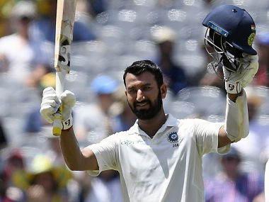 India's Cheteshwar Pujara celebrates scoring a century during play on day two of the third cricket test between India and Australia in Melbourne, Australia, Thursday, Dec. 27, 2018. (AP Photo/Andy Brownbill)