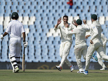 South Africa's bowler Duanne Olivier, second left, celebrates with teammates after dismissing Pakistan's batsman Azhar Ali for a duck on day two of the first cricket test match between South Africa and Pakistan at Centurion Park in Pretoria, South Africa, Thursday, Dec. 27, 2018. (AP Photo/Themba Hadebe)