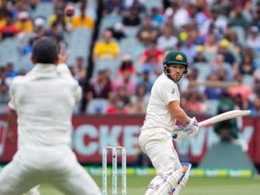 Australia's Aaron Finch batting edges the ball as he looks back before being caught out for 3 runs during play on day four of the third cricket test between India and Australia in Melbourne, Australia, Saturday, Dec. 29, 2018. (AP Photo/Asanka Brendon Ratnayake)