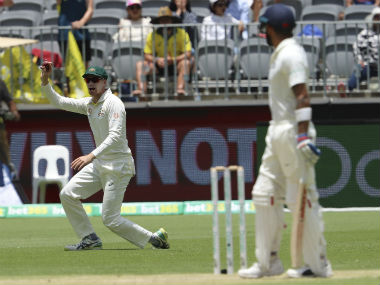 Peter Handscomb celebrates after collecting a catch in the slips to dismiss Virat Kohli on Day 3. AP
