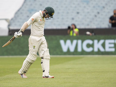 Australia's Travis Head walks off after he gets out bowled during play on day four of the third cricket test between India and Australia in Melbourne, Australia, Saturday, Dec. 29, 2018. (AP Photo/Asanka Brendon Ratnayake)