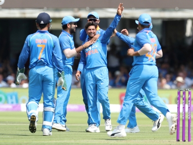 India team members celebrate a fall of wicket. Reuters