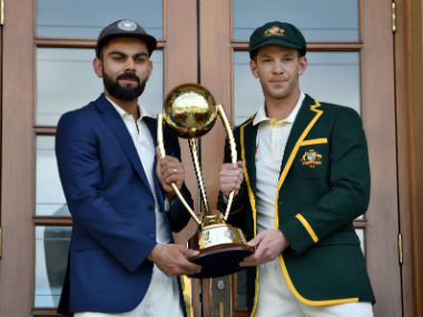 Virat Kohli and Tim Paine, captain of India and Australia respectively, pose with the Border Gavaskar Trophy. AFP