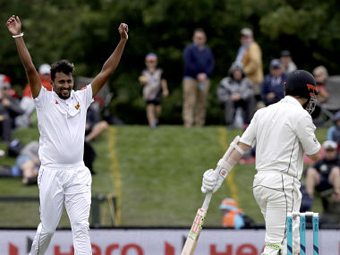Suranga Lakmal (L) celebrates after dismissing Kane Williamson (R) on day one of the second cricket Test between New Zealand and Sri Lanka at Hagley Oval. AP
