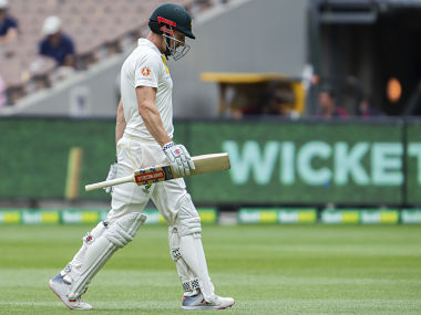 Shaun Marsh walks off after getting out LBW for 44 runs during play on day four of the third cricket test between India and Australia in Melbourne, Australia, Saturday, Dec. 29, 2018. (AP Photo/Asanka Brendon Ratnayake)
