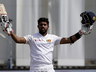 Sri Lanka's Kusal Mendis celebrates after scoring a century during play on day four of the first cricket test between New Zealand and Sri Lanka in Wellington, New Zealand, Tuesday, Dec. 18, 2018. (AP Photo/Mark Baker)