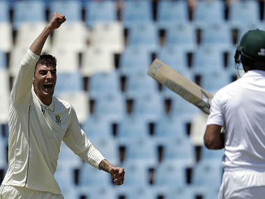 Duanne Olivier (L) celebrates after dismissing Fakhar Zaman on Day 2 of the 1st Test. AP
