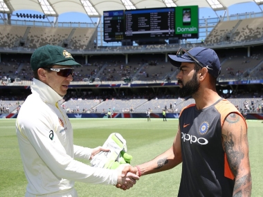 Captains Tim Paine (L) and Virat Kohli shake hands after the second Test. AP