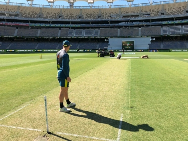 Australian skipper Tim Paine having a look at the Perth pitch before the start of second Test. Image: Twitter @cricketcomau