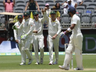 Peter Handscomb celebrates after collecting a catch in the slips to result in Virat Kohli's dismissal for 123. AP
