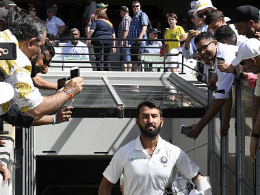 India's Cheteshwar Pujara enters the field before play on day two of the third cricket test between India and Australia in Melbourne, Australia, Thursday, Dec. 27, 2018. (AP Photo/Andy Brownbill)