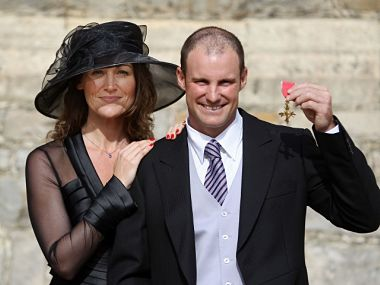 In this picture, Andrew Strauss poses for photographs with his wife Ruth, after receiving his Order of the British Empire. AFP