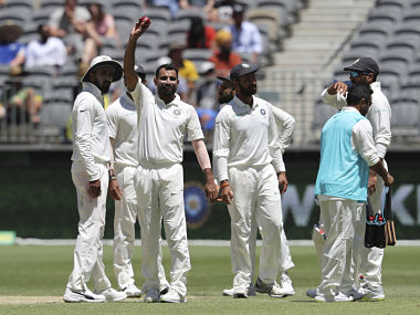 Mohammed Shami holds up the ball after scalping 5 wickets in Australia's second innings in Perth Test. AP