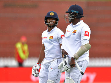 Sri Lanka's Kusal Mendis (L) and teammate Angelo Mathews walk from the field as rain starts to fall during day five of the first Test cricket match between New Zealand and Sri Lanka at the Basin Reserve in Wellington on December 19, 2018. (Photo by Marty MELVILLE / AFP)