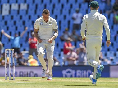 South Africa's Dale Steyn (L) celebrates after getting the wicket of Pakistan's Fakhar Zaman during day one of the 1st cricket test match between South Africa and Pakistan at SuperSport Park cricket stadium in Pretoria on December 26, 2018. (Photo by Christiaan Kotze / AFP)