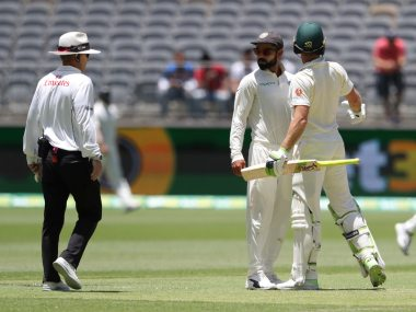 Virat Kohli and Tim Paine came face-to-face during fifth day's play at Perth. AP