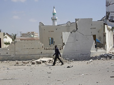 Toll in bomb blast at Somalias Mogadishu rises to 20 president condemns attacks PM visits wounded