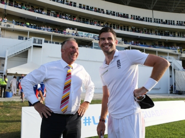 File image of legendary former England cricketer Ian Botham (L) along with swing king James Anderson. Reuters