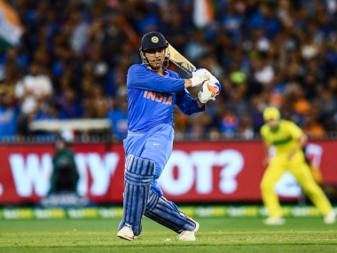 MS Dhoni is a superstar and an all time great, gushes Australia coach Justin Langer. AFP