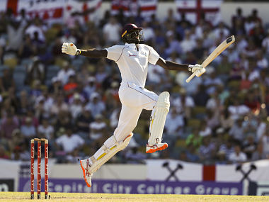 West Indies' captain Jason Holder celebrates after scoring a double century against England during day four of the first cricket Test match at the Kensington Oval in Bridgetown, Barbados, Friday, Jan. 25, 2019. (AP Photo/Ricardo Mazalan)