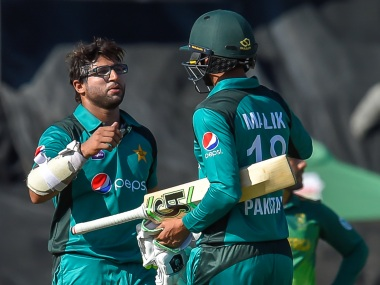 Imam-ul-Haq celebrates with Shoaib Malik after getting to his century during the third ODI against South Africa. AFP