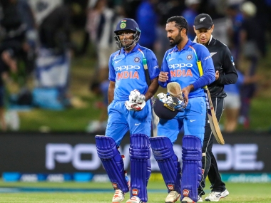 India's Ambati Rayudu and Dinesh Karthick leave the field after the third one day international between India and New Zealand at Bay Oval, Tauranga, New Zealand, Monday, January 28, 2019. (AP Photo/John Cowpland)