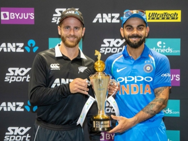 Kiwi captain Kane Williamson (L) and India skipper Virat Kohli pose with the trophy ahead of the five-match ODI series. Image: Twitter @BCCI