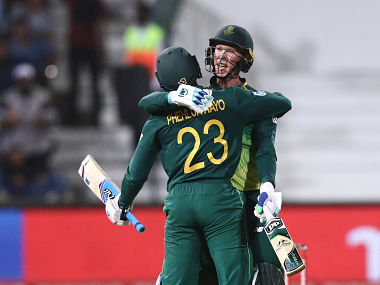 South Africa's Rassi evand der Dussen hugs Andile Phehlukwayo (23) after their win during the 2nd One Day International Cricket match between South Africa and Pakistan held at the Kingsmead Cricket Stadium in Durban on January 22, 2019. (Photo by PASCAL PAVANI / AFP)