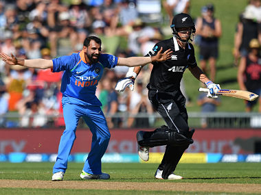 Mohammed Shami (L) appeals successfully for a leg-before-wicket (LBW) against Mitchell Santner (R) during the 1st ODI. AFP
